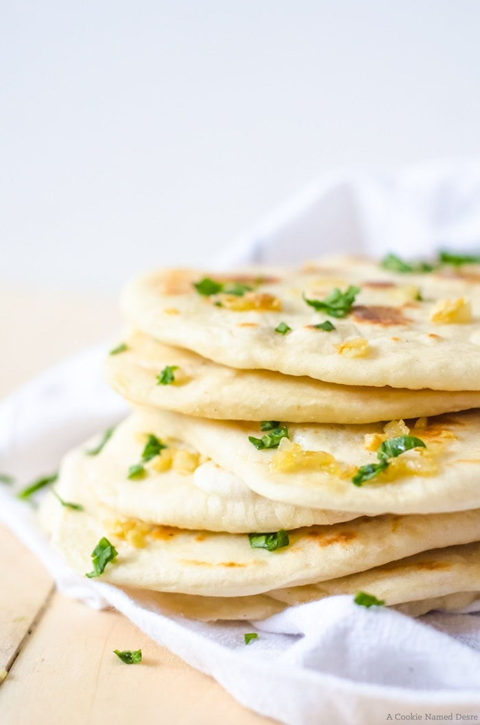 Warm, soft homemade naan bread is easier to make than you may think. This easy bread recipe is the perfect accompaniment to your dinner or as a snack!