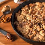 peanut butter chocolate chip and pretzel skillet cookie with nutella