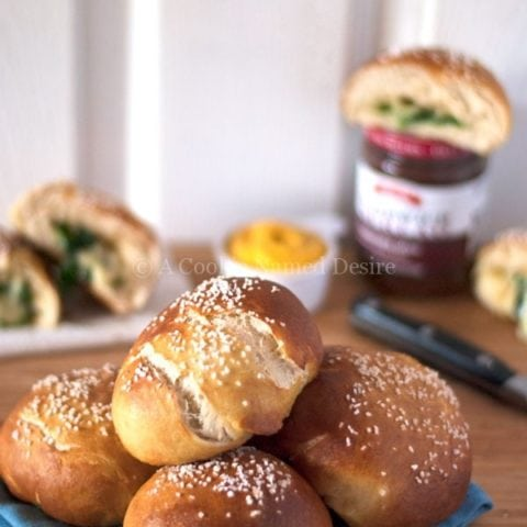 brie and spinach stuffed pretzel rolls