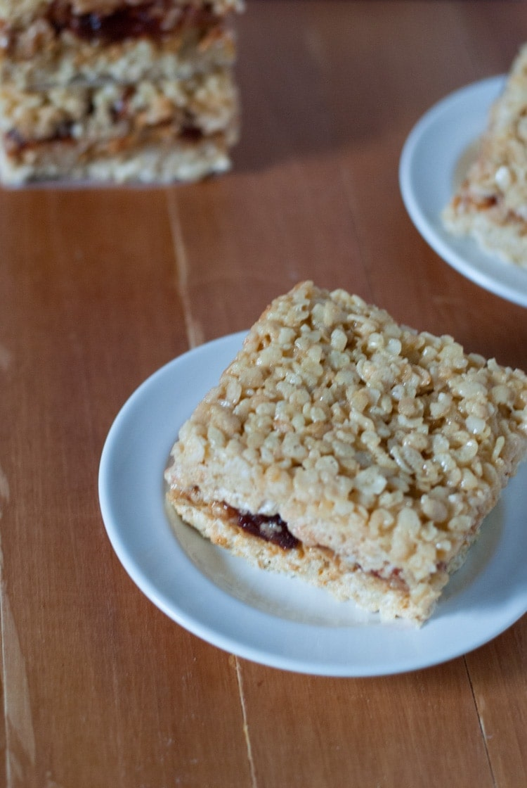 Peanut Butter and Jelly Rice Krispie Treats. These little treats combine two childhood favorites in one. | cookienameddesire.com