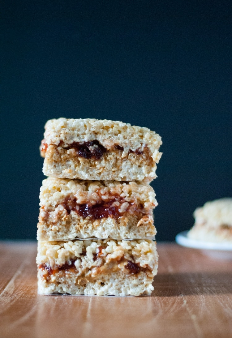 Peanut Butter and Jelly Rice Krispie Treats. Two childhood favorites meet to create the ultimate dessert.  | cookienameddesire.com