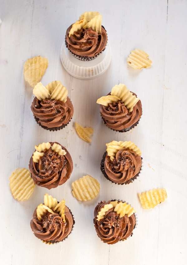 Incredible chocolate  cupcakes with coffee glaze, chocolate ganache, right chocolate buttercream, caramel drizzle, fleur de sel and potato chips. Heaven in a cupcake.