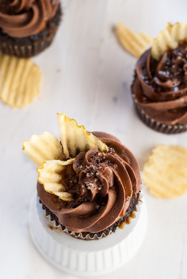 Incredible chocolate cupcake with coffee glaze, chocolate ganache, right chocolate buttercream, caramel drizzle, fleur de sel and potato chips. Heaven in a cupcake.