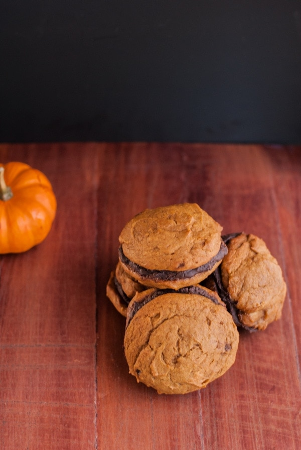 Pumpkin whoopie pies with a caramel glaze and boozy ganache filling - yes, please ! @cookiedesire