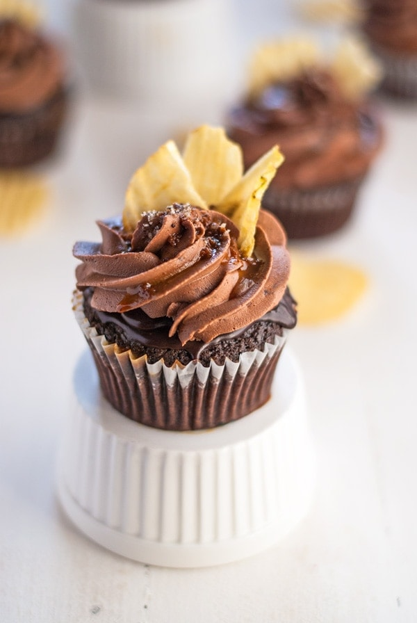 "An incredible chocolate ""chip"" cupcake with coffee glaze, chocolate ganache, right chocolate buttercream, caramel drizzle, fleur de sel and potato chips. Heaven in a cupcake."