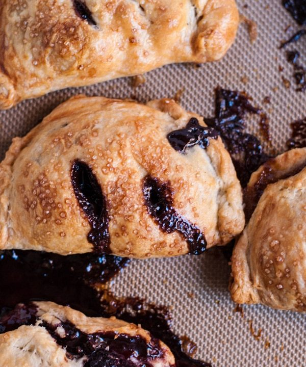 Pear and chocolate hazelnut hand pies with an incredibly flaky pie crust. Seriously, the best pie I've ever had!