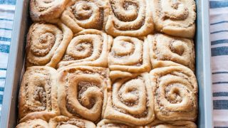 Sticky Rolls with Pecan Bourbon Maple Filling and Eggnog Glaze