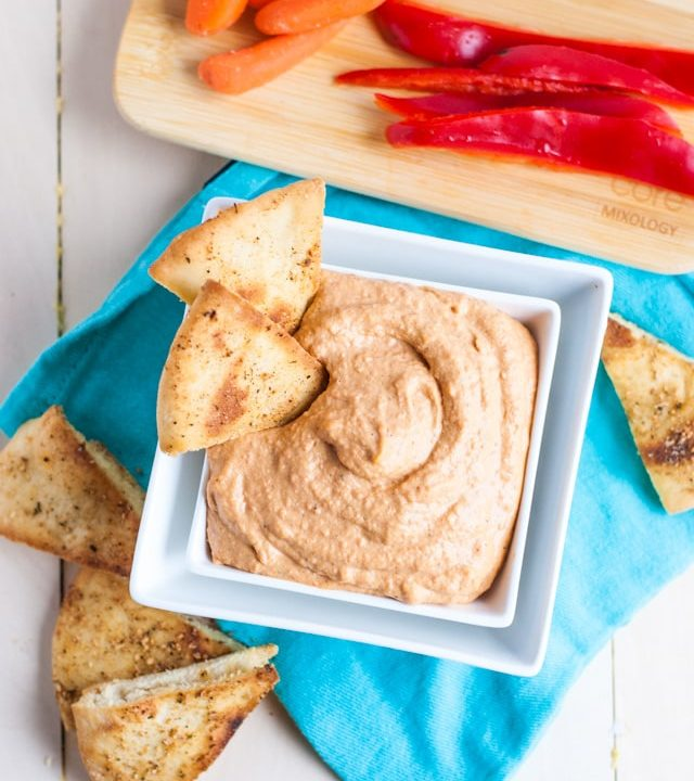 The creamiest roasted red pepper hummus with spiced pita chips