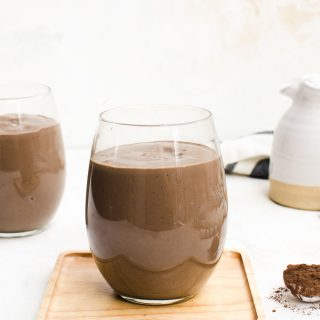 avocado chocolate peanut butter smoothie in a glass