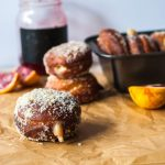 Blood orange cream-filled doughnuts. The perfect doughnuts with a crisp outer and soft, fluffy bread inside and a sweet, tangy cream