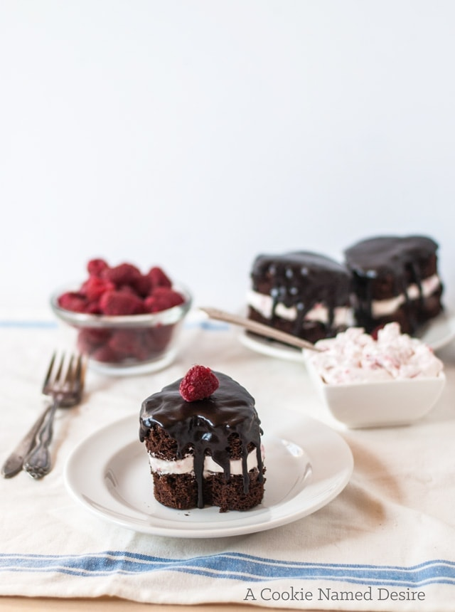 Valentine's Day dessert: mini heart-shaped chocolate cakes with rapsberry whipped cream and ganache