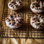 triple cinnamon brown butter doughnuts with candied cinnamon pecans