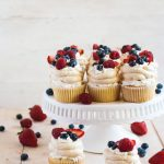 Pavlova cupcakes with honey-sweetened whipped cream