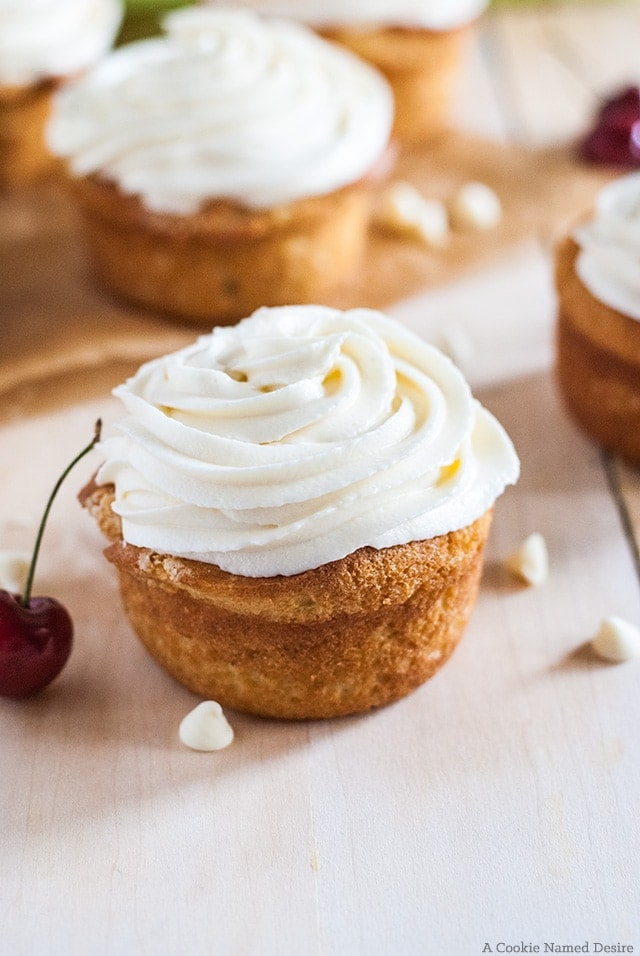 vanilla buttermilk cupcakes with cherry rhubarb filling and white chocolate frosting