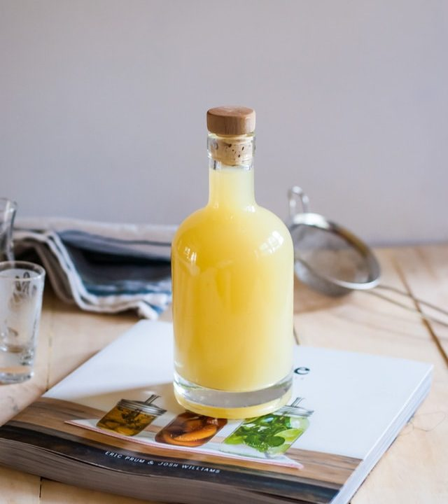 bottle of limoncello on top of book