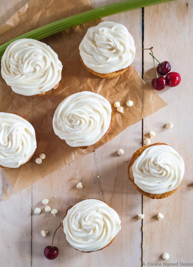 vanilla cupcakes filled with cherry rhubarb compote and topped with white chocolate frosting