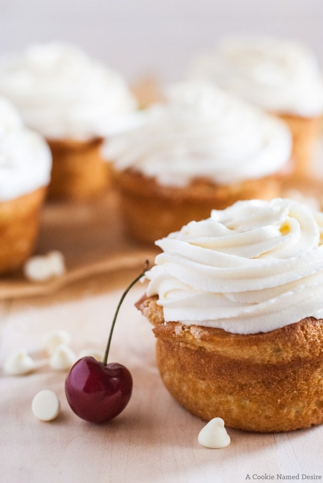 fresh cherry rhubarb cupcakes with white chocolate frosting