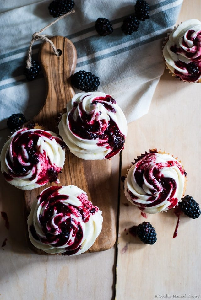 Blackberry cupcakes with lime frosting and blackberry drizzle