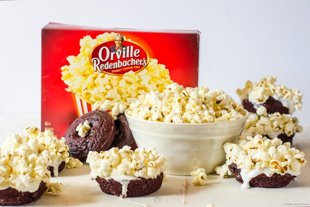 Red velvet doughnuts with marshmallow topping and Orville popcorn