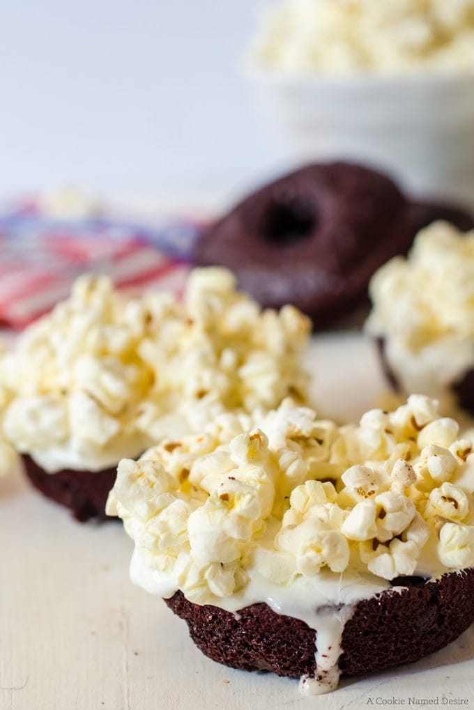 moist baked red velvet doughnuts with marshmallow goop and buttery popcorn topping