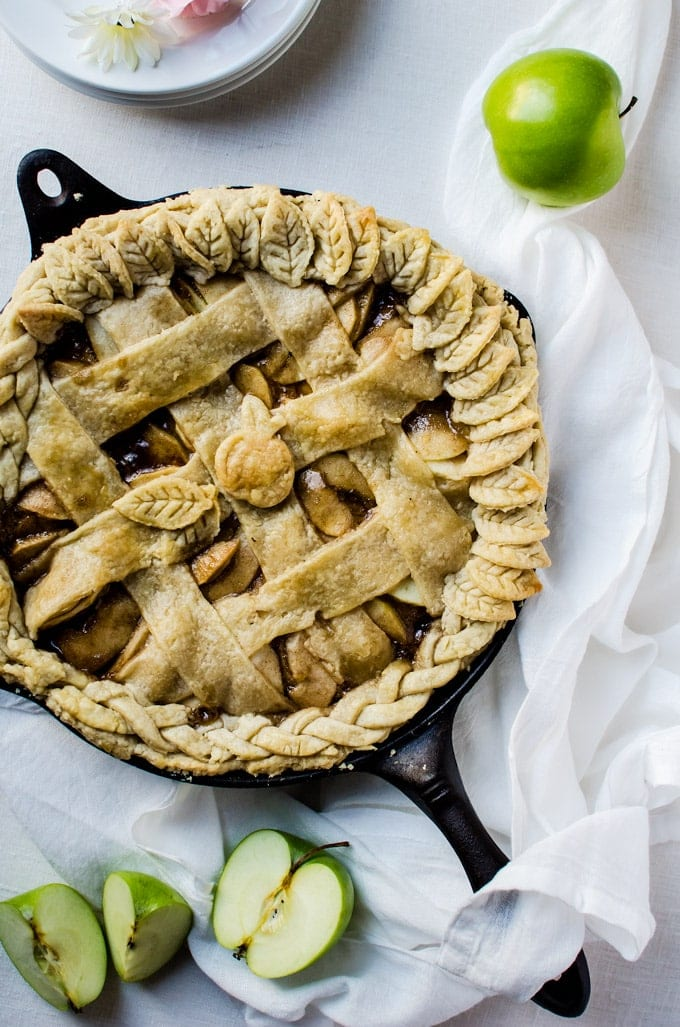 A rich caramel skillet apple pie with a flaky and buttery crust.