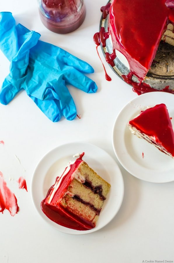 Bloody white cake with raspberry jam and red velvet ganache