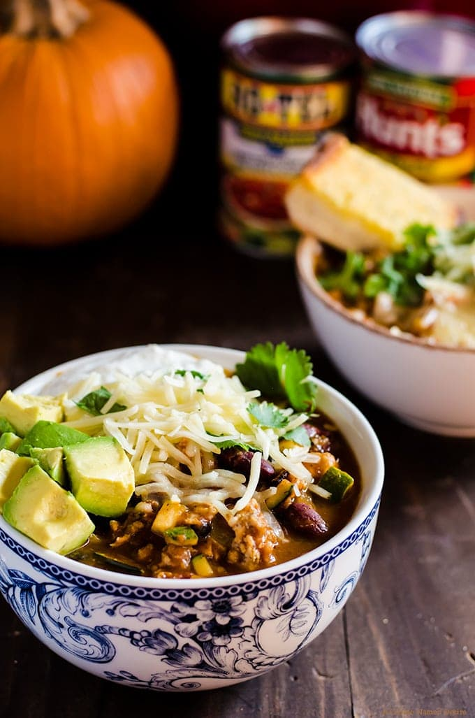 Pumpkin chili with lean ground turkey and a ton of veggies. The perfect healthy slow cooker dinner