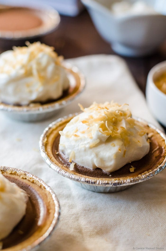 No bqke chocolate pudding pies wih whipped cream and toasted coconut. The perfect light dessert