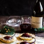 Wine poached pear tarts make a great holiday party dessert to pair with your favorite pinot noir