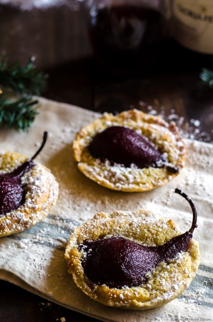 Have your wine and eat it too with these eligant poached pear tarts. These little desserts make the perfect holiday treat to pair with your favorite pinot noir