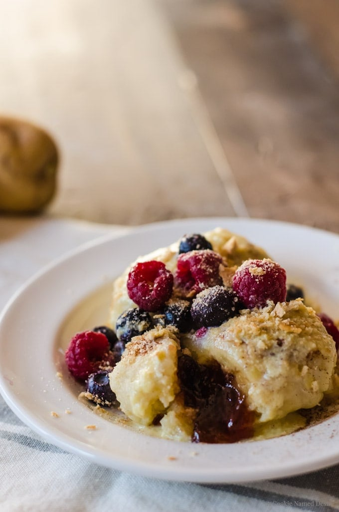 Sweet plum jam gnocchi with berries and vanilla bean creme anglaise