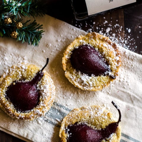 Pair your favorite pinot noir with these wine poached pear tarts for a truly amazing holiday get together