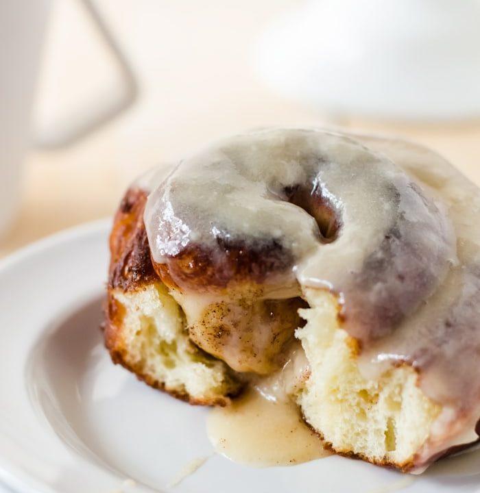 Cinnamon bun doughnuts with cream cheese glaze. Cinnamon buns and doughnuts had a baby and it. is. glorious!