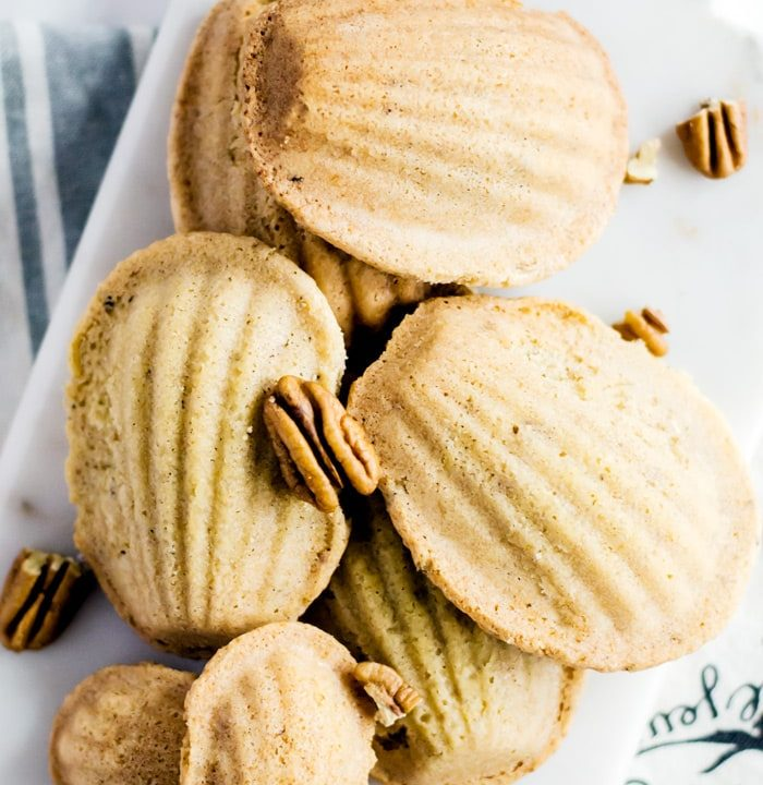 Brown butter pecan madeleines are the epitome of rich and indulgent nutty flavor. The brown butter gives the madeleines and intoxicating aroma and the pecans add a welcome crunch. These dainty cookies are best served fresh from the oven while they are still warm, making them an incredible wintertime treat.