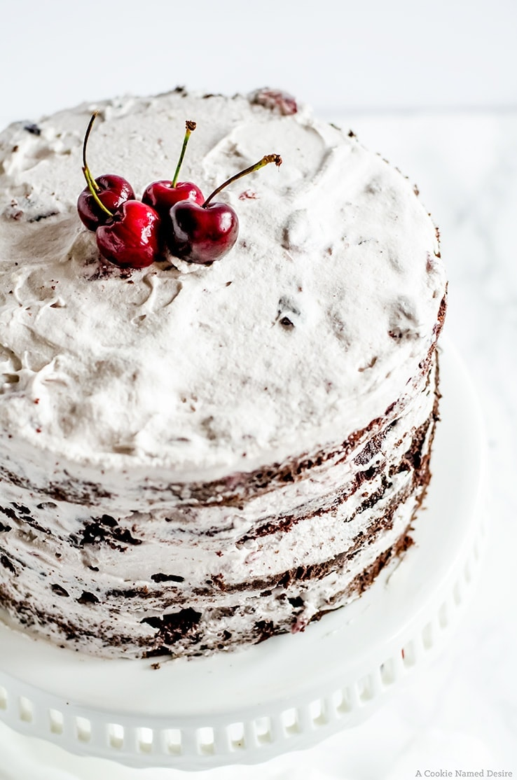 A moist chocolate cherry cake with a rich chocolate cake and a smooth cherry swiss meringue buttercream