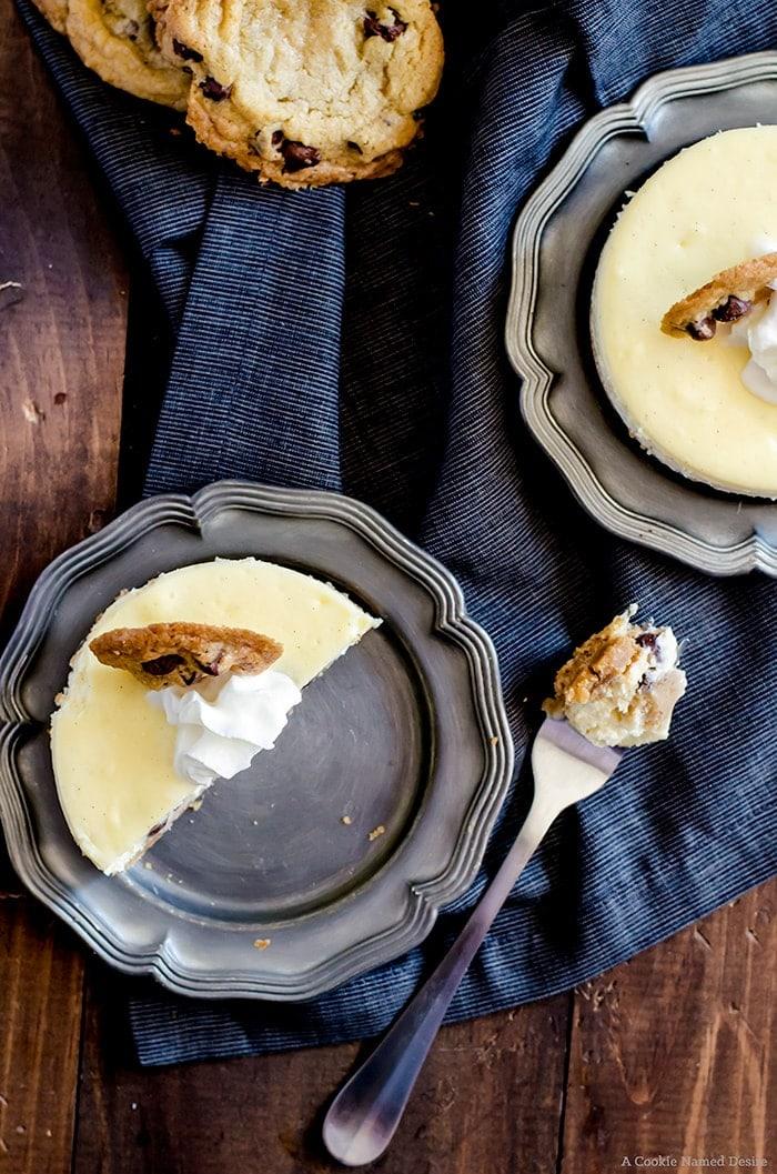 Mini Chocolate Chip Cookie Dough Cheesecake.... velvety smooth vanilla cheesecakes stuffed with chocolate chip cookie dough. Topped with fresh whipped cream and a mini chocolate chip cookie. The ultimate dessert-lovers treat