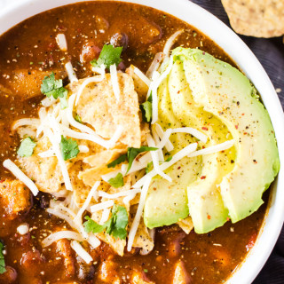 No one will believe this easy chicken enchilada soup was finished in under 30 minutes! It is rich, full of flavor, and bound to be your new favorite weeknight dinner recipe.