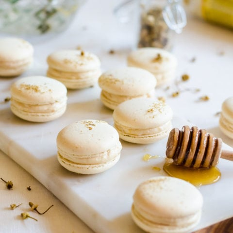 These chamomile and caramelized honey macarons are the perfect treat for all your spring gatherings. The macaron shells are delicately flavored with chamomile and filled with a lightly salted caramelized honey buttercream. It's Spring in a single bite.