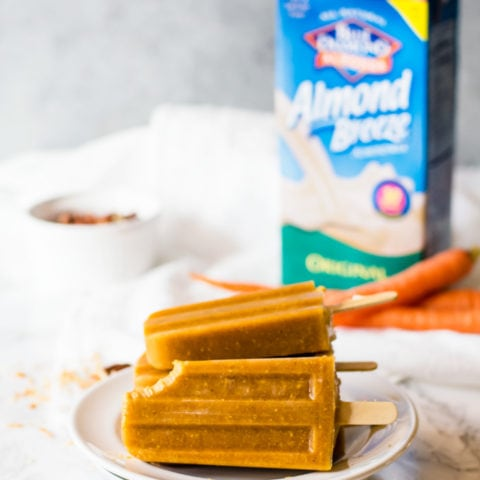 Carrot cake popsicles are a delightfully refreshing take on the classic cake. Made with fresh carrots and all the aromatic spices and flavors we love in traditional carrot cake. This simple popsicle recipe is made easily in a blender in just moments!