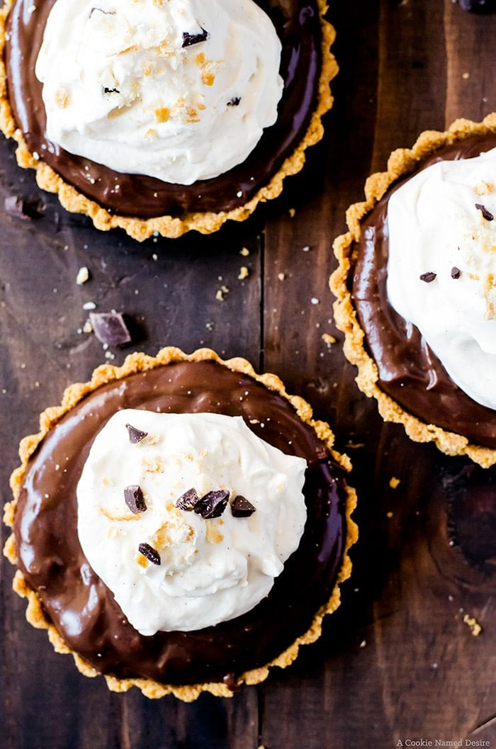 Lusciously smooth chocolate pudding tarts with a sweet and salty cracker crust. This easy no-bake recipe proves sweet and salty is the best flavor combination.