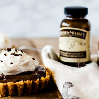 Chocolate pudding tart with a cracker crust and fresh whipped cream