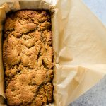 A dense coconut cinnamon bread made with different types of coconut and a hint of cinnamon.