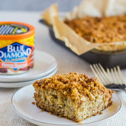 Irresistibly moist and flavorful banana coffee cake with the crunchiest graham cracker streusel made with honey roasted almonds. You won't be able to stop at just one slice of this coffee cake!