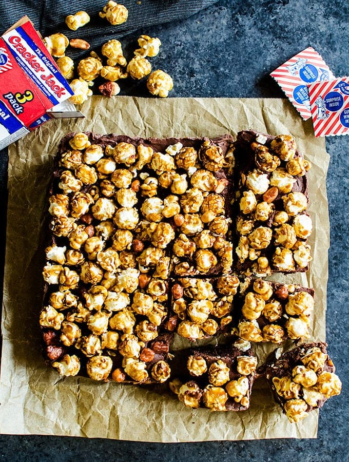 You are going to love this chocolate caramel fudge topped with Cracker Jack popcorn. It's a fun nostalgic treat you and your kids will love!