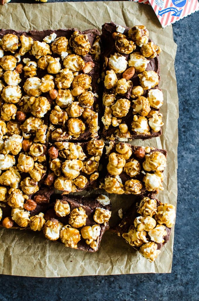 The easiest chocolate caramel fudge topped with the amazing cracker jack popcorn. Is this your new favorite dessert? I think so!