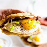 These American breakfast tacos are the perfect on-the-go way to get a full breakfast food truck style. Light and fluffy pancakes act as a vehicle for thick slices of bacon, melted cheese, and fried eggs. Smother the whole thing in maple syrup and you have the best breakfast ever!