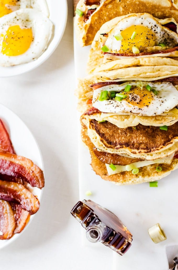 American breakfast tacos... Light and fluffy pancakes act as a vehicle for thick slices of bacon, melted cheese, and fried eggs. Smother the whole thing in maple syrup and you have the best breakfast ever!