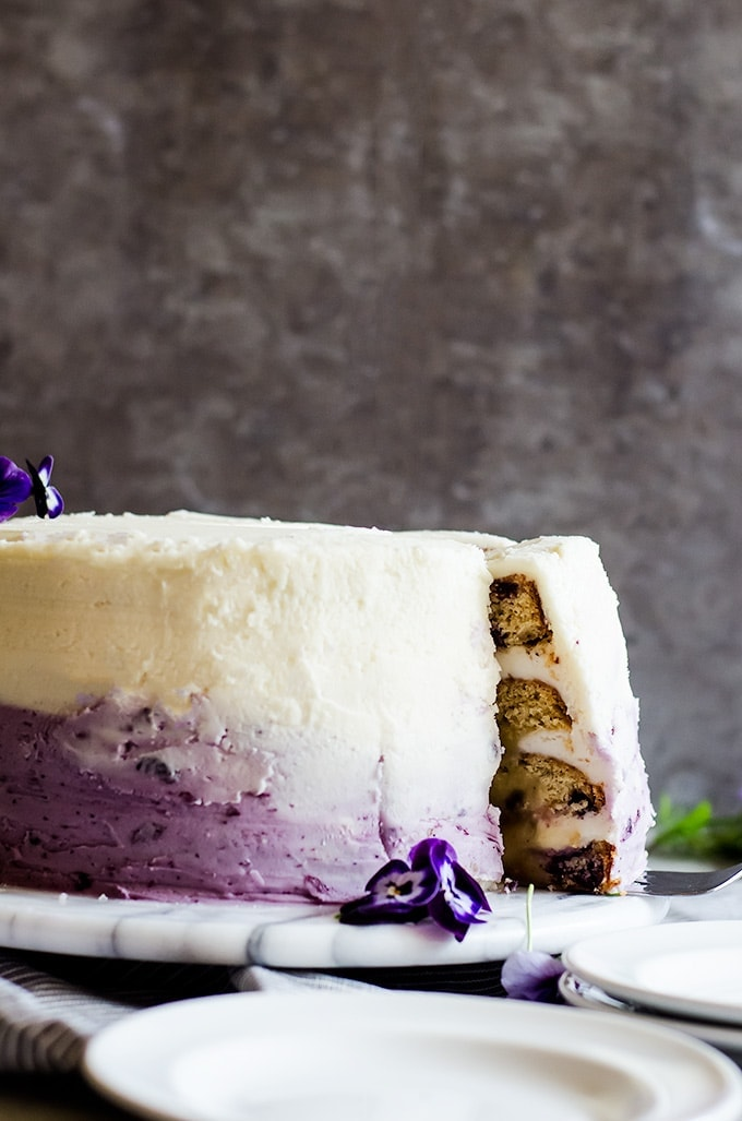 A delicious lemon blueberry cake with lemon curd and a gorgeous blueberry ombre frosting. This cake is a stunning crown pleaser.