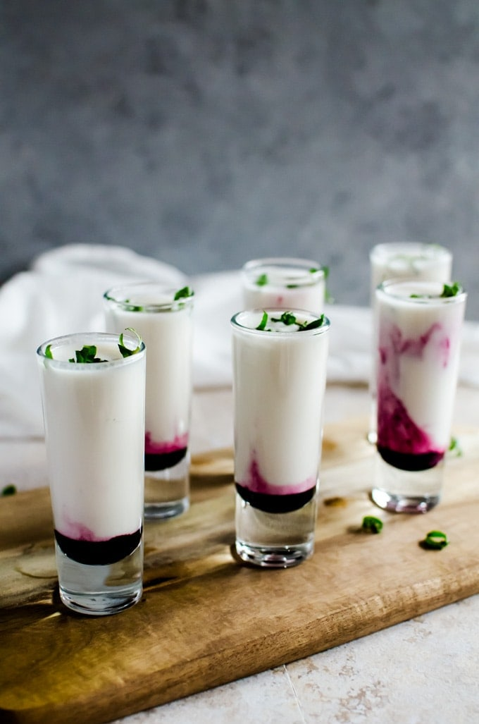 These creamy and topical coconut lime mojito shooters will be your new summer favorite. You can easily make this recipe ahead of time for easier party planning!