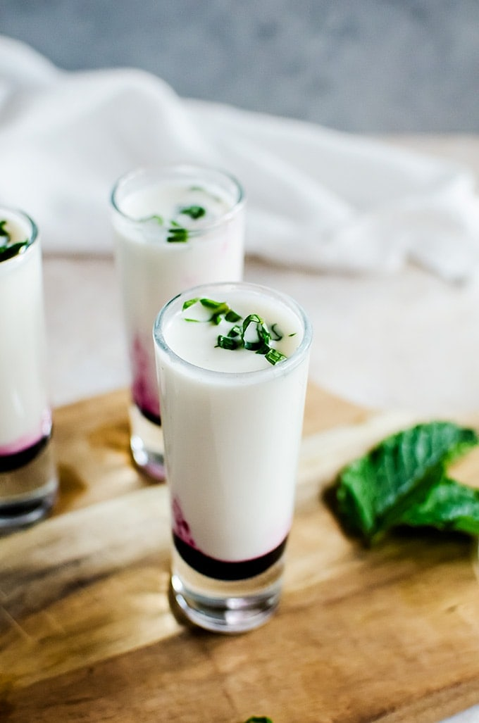 A creamy and irresistible coconut lime mojito shooter with a blueberry swirl. Aka the best shot you will ever make.